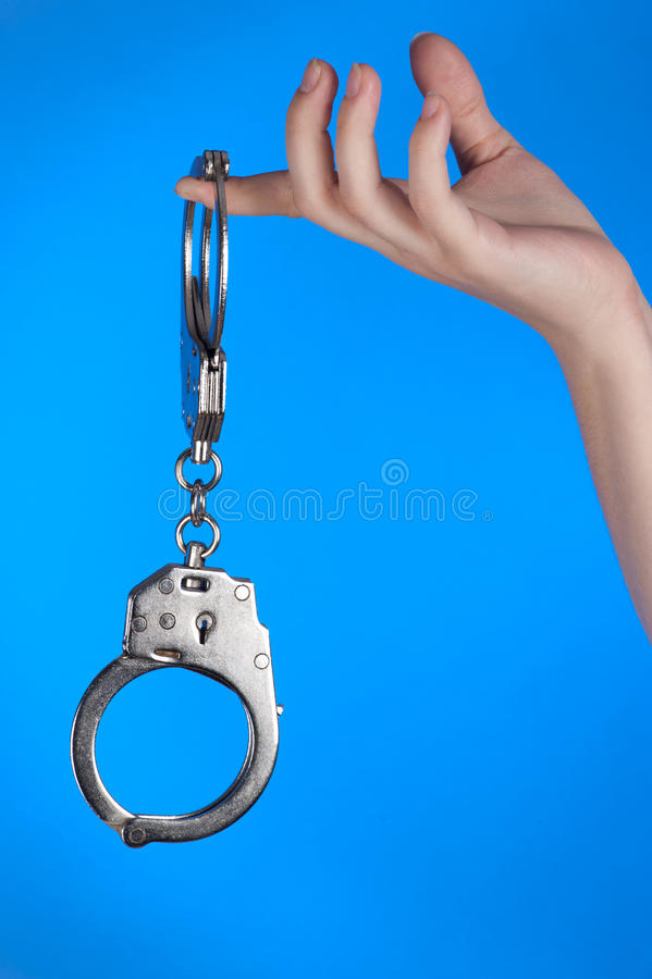 Download Handcuffs in hand stock photo. Image of handcuffs, formal - 22062644