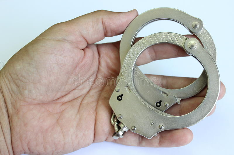 Handcuffs in the hand stock image