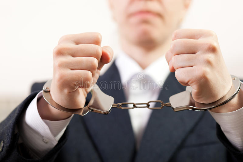 Handcuffs on hands stock image