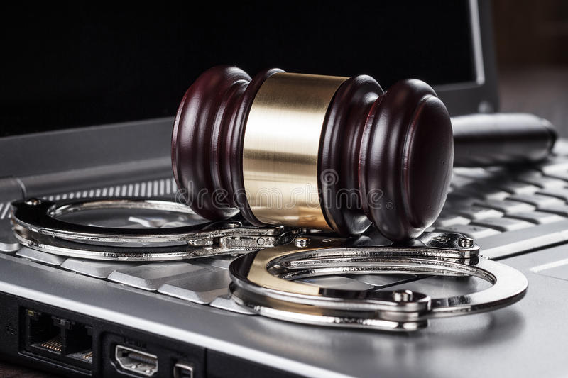 Download Handcuffs And Judge Gavel On Computer Concept Stock Photos - Image: 30750963