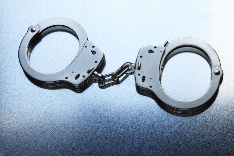 Download Handcuffs locked stock photo. Image of arrest, capture - 14852564