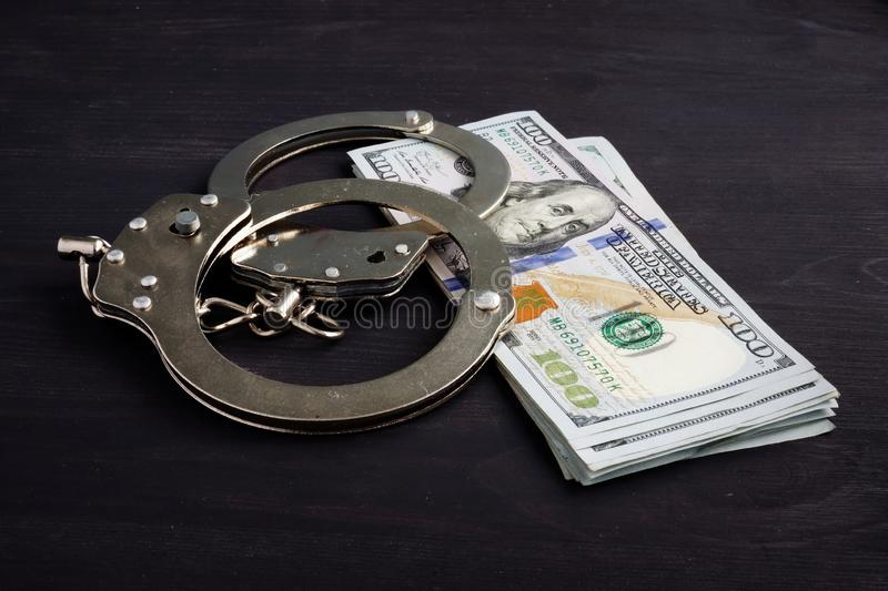 Handcuffs and money. Dollars for bail bonds royalty free stock photography