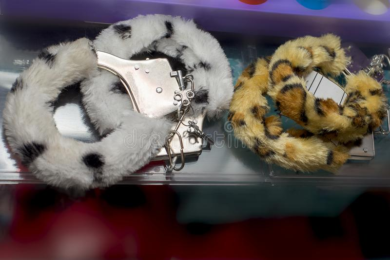 Handcuffs, sex toys, soft and furry royalty free stock photo