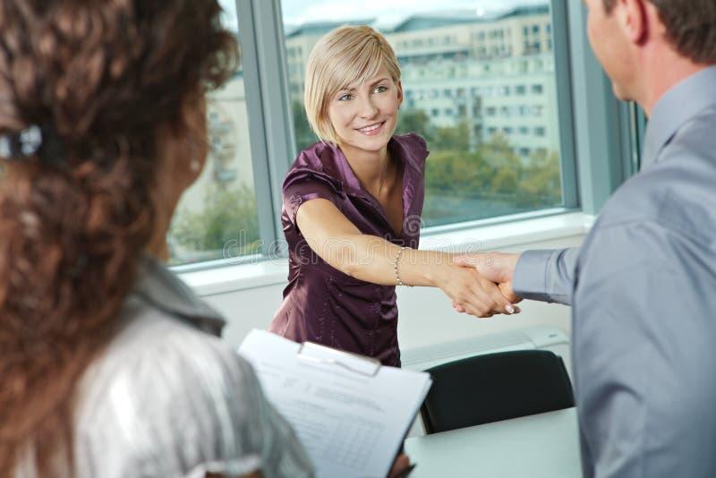 Handdruk op commerciële vergadering stock foto's