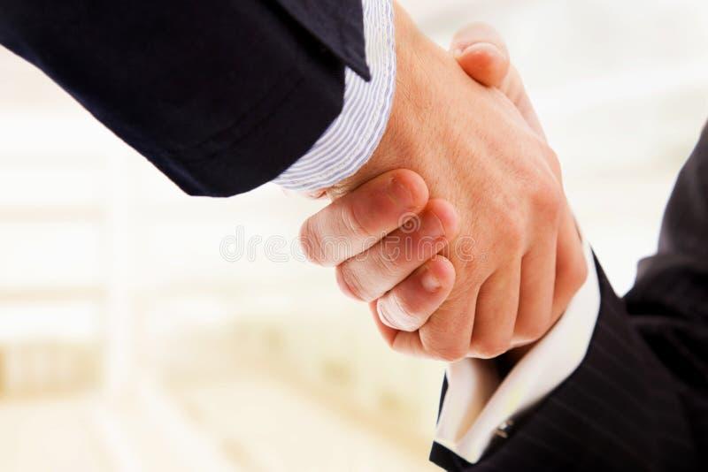 Handdruk van partners stock foto's