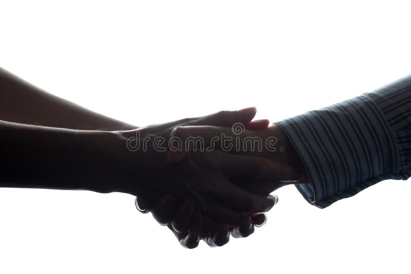 Handdruk van twee vrouwen, een bedrijfsovereenkomst - silhouet royalty-vrije stock fotografie