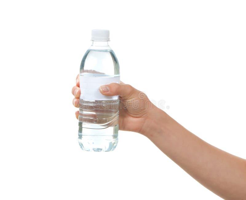 Handeinflußflasche Trinkwasser lizenzfreie stockfotos