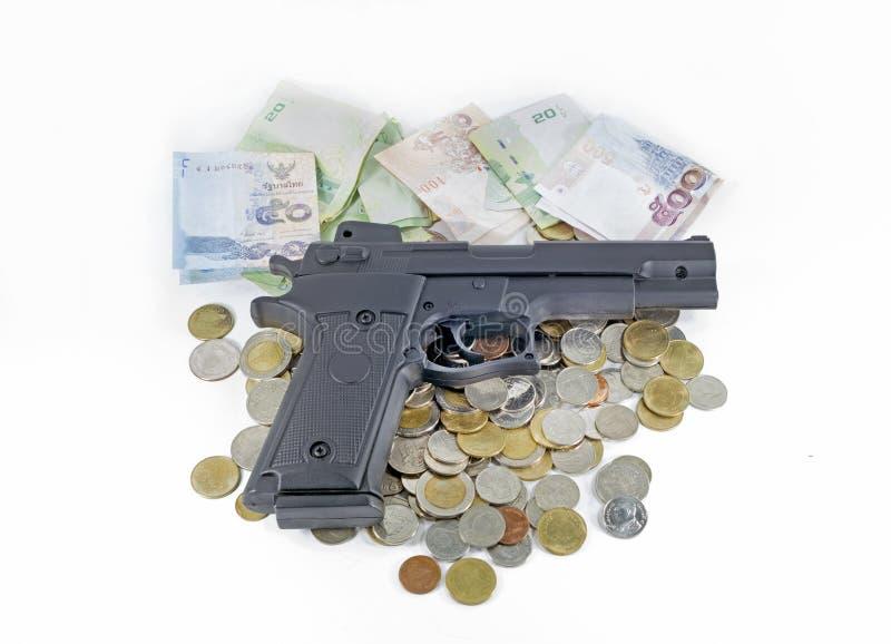 Handeldvapen på thai pengarsedlar och mynt royaltyfria bilder