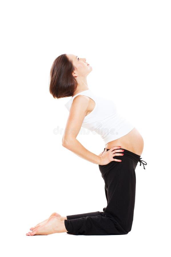 Handeln der schwangeren Frau der Junge gymnastisch lizenzfreie stockfotos