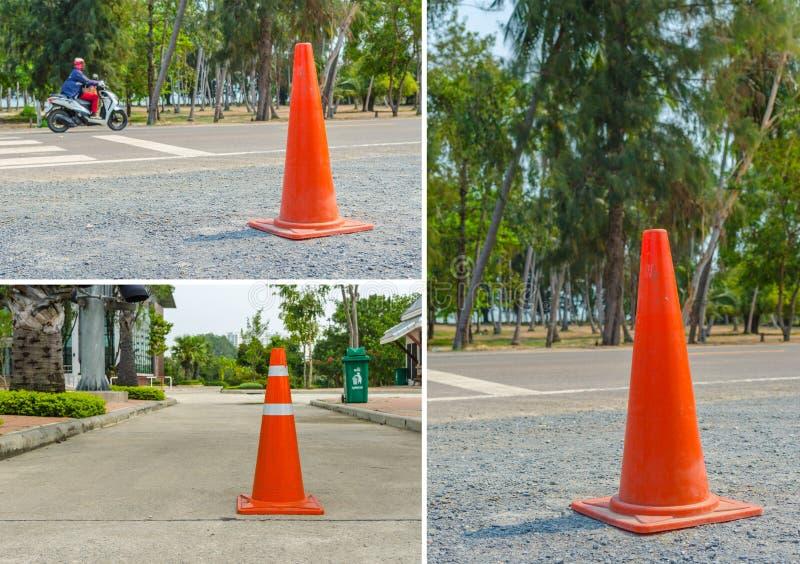 Handeln Sie Kegel, mit den weißen und orange Streifen stockfotografie