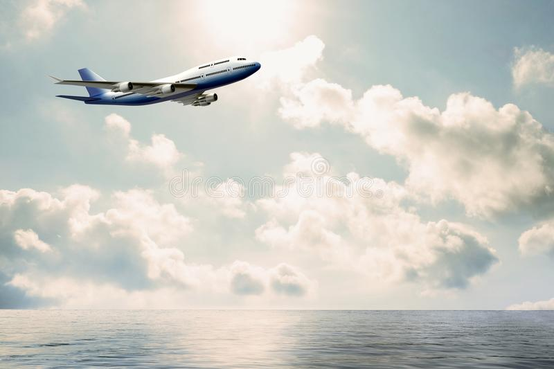 Handelsflugzeug, das über Wasser fliegt stockfotografie