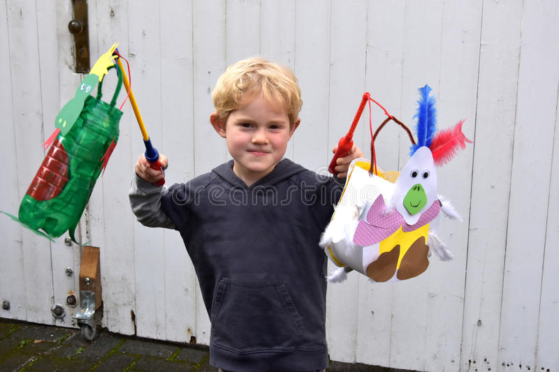 Handemade lanterns for Martinmas. Boy with handemade paper lanterns for Martinmas procession royalty free stock image