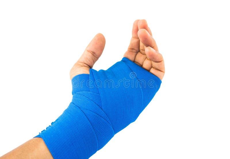 Handen bunden blå resår förbinder arkivfoto
