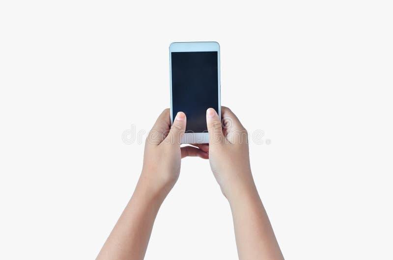 Handen die de telefoon houden die twee handen gebruiken stock foto