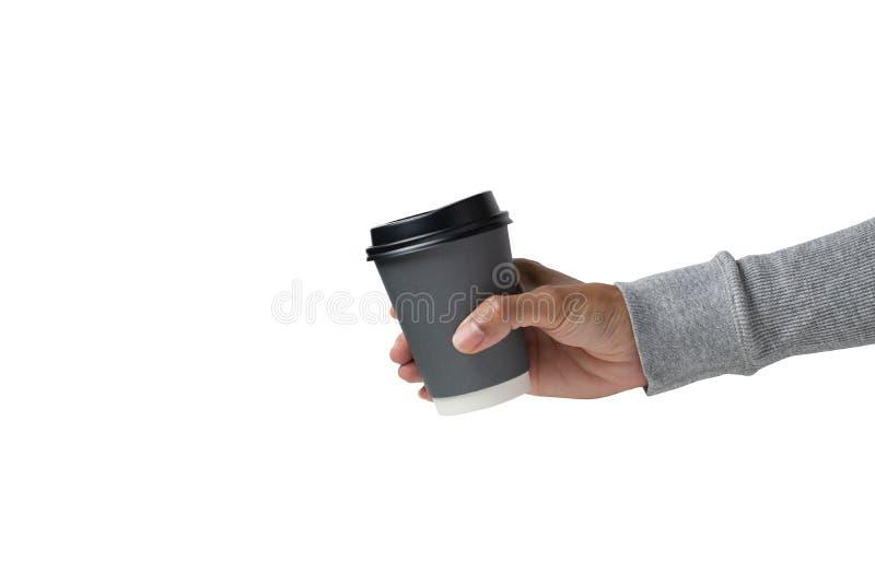 Handen die een warme koffiekop op een witte achtergrond houden stock afbeeldingen