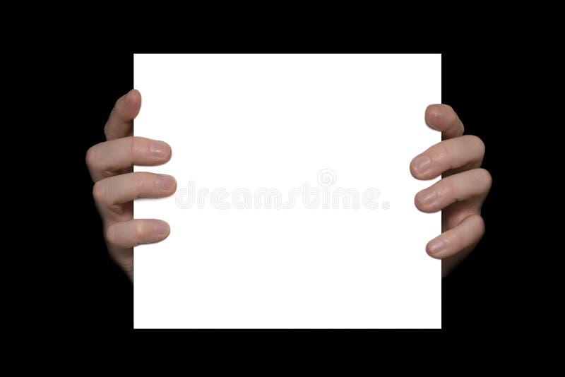 Handen die een witte raad houden stock afbeelding