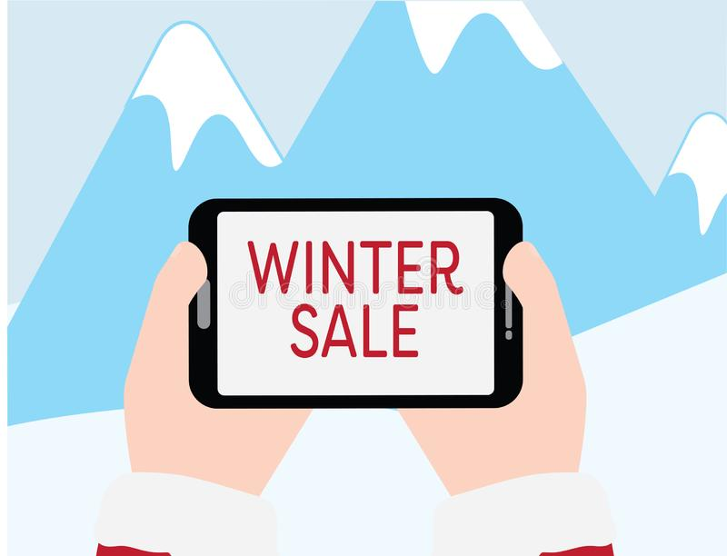 Handen die tablet met de tekst van de de WINTERverkoop op Blauwe bergen met sneeuwachtergrond houden stock illustratie