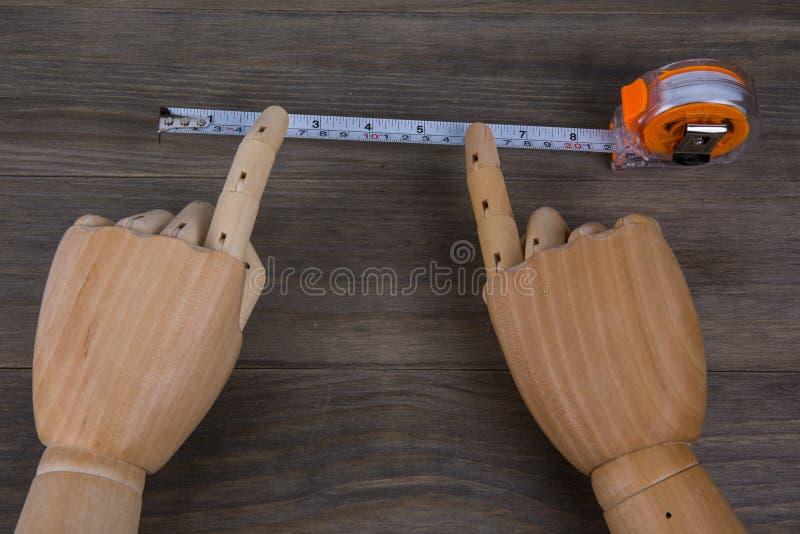 Handen en Meetlint stock afbeelding