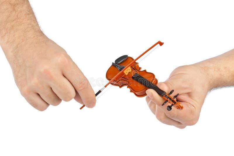 Download Handen En Stuk Speelgoed Viool Stock Afbeelding - Afbeelding bestaande uit holding, melodie: 54090093