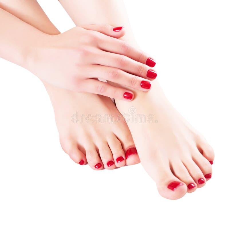 Handen en voeten op een wit close-up als achtergrond royalty-vrije stock fotografie