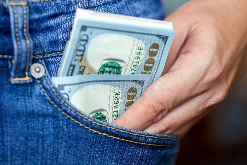 Handen får dollar från ett fack fotografering för bildbyråer
