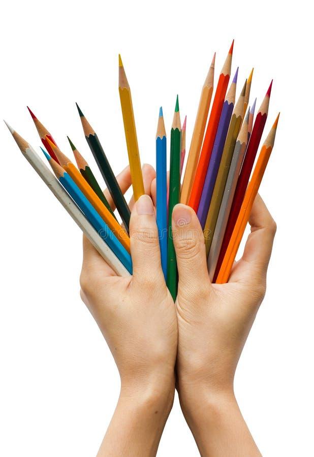 Handen met Kleurpotloden stock foto's