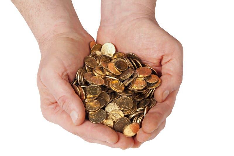 Handen met muntstukken stock afbeelding