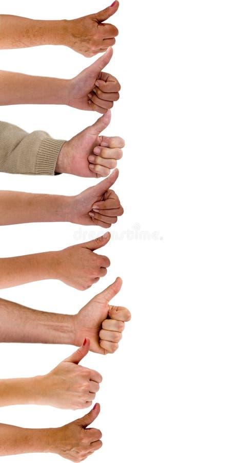 Handen met omhoog duimen stock afbeeldingen