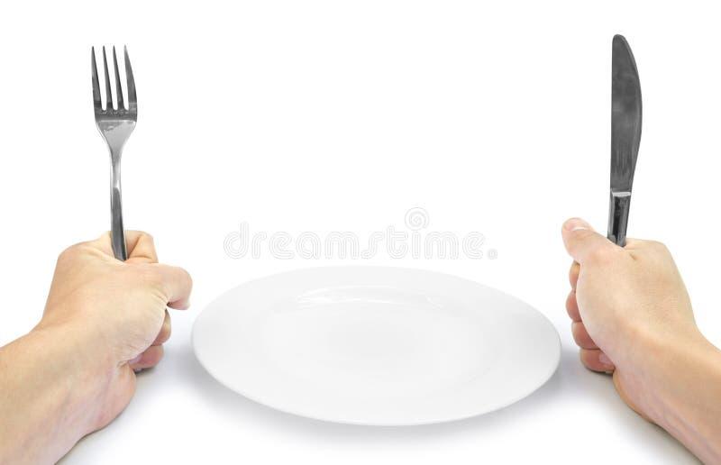 Handen met tafelzilver stock fotografie