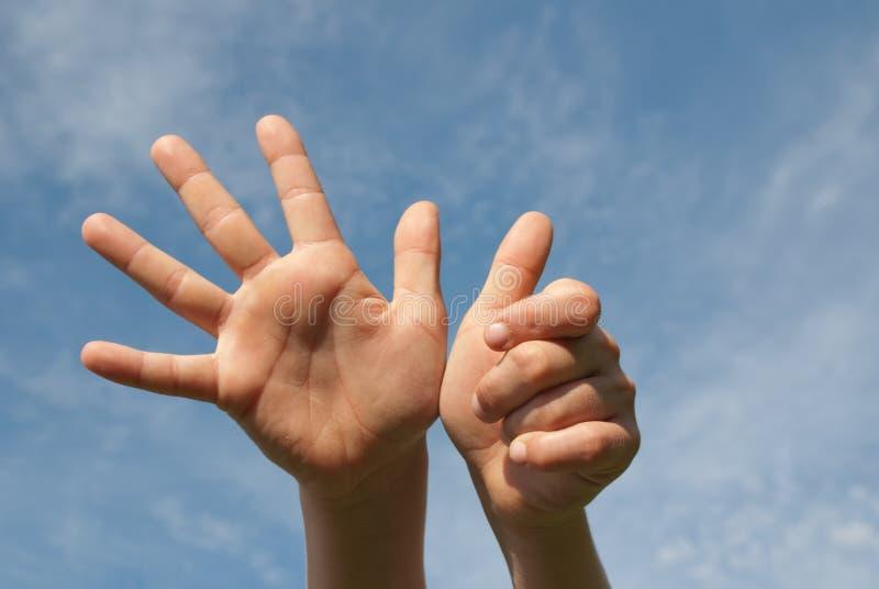 Handen omhoog stock afbeelding