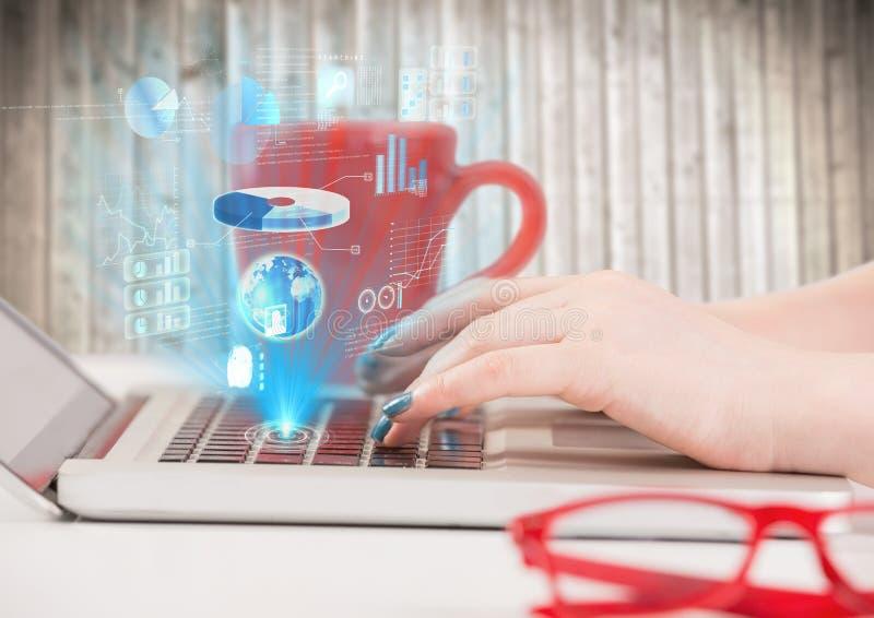 Handen op laptop met blauwe interface die uit toetsenbord tegen onscherp houten paneel komen royalty-vrije stock afbeeldingen