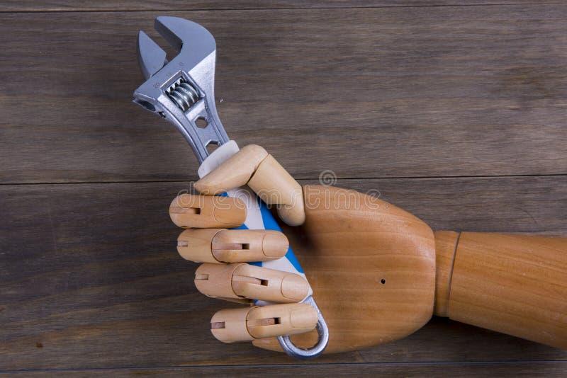 Handen rymmer en spinnare royaltyfri foto