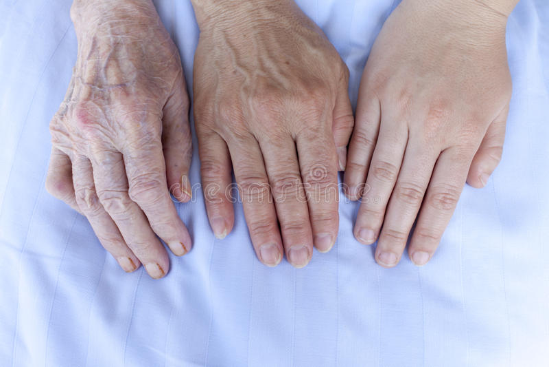 Handen van drie generaties royalty-vrije stock afbeelding