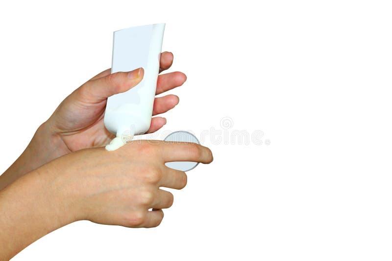 Handen van vrouwen smerende die room, op witte achtergrond worden geïsoleerd, Gezonde levensstijl royalty-vrije stock foto's