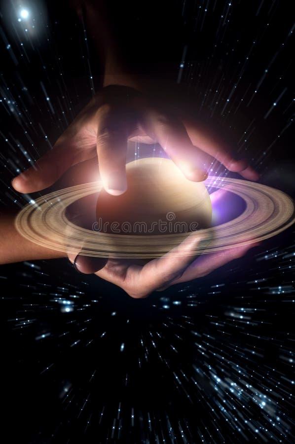 Handenplaneet Saturn royalty-vrije stock afbeelding