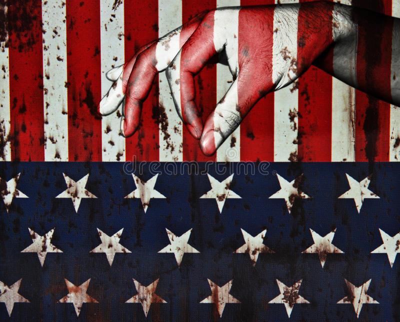 Handfingret för ger sig på USA-flaggabakgrund fotografering för bildbyråer