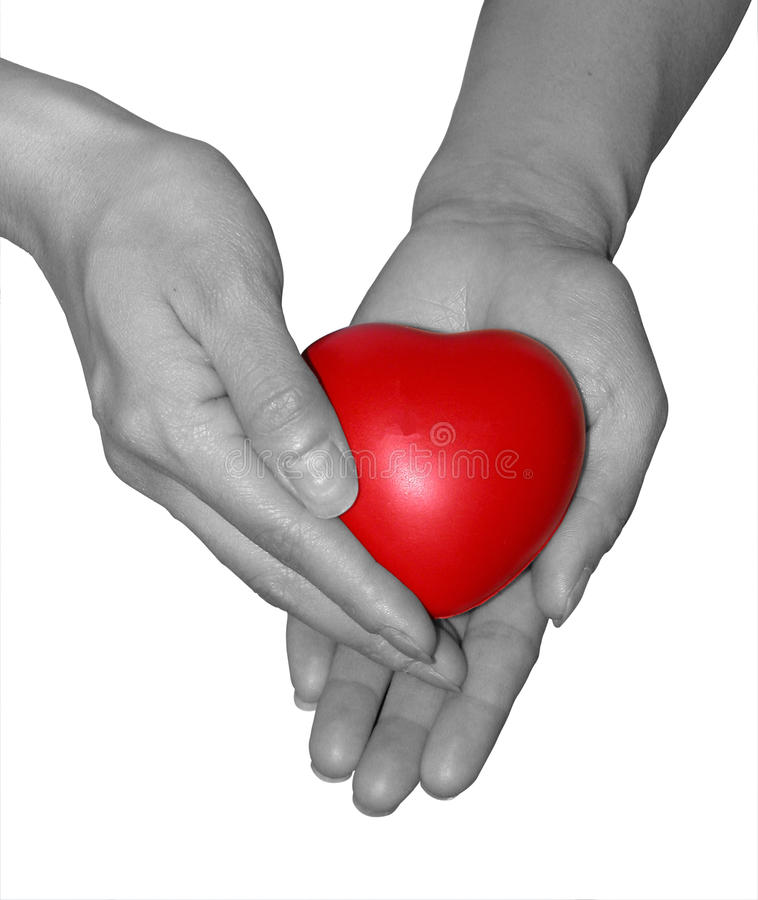 Handful of Care. B&w hand holding a red heart symbolizing handful of care royalty free stock photos