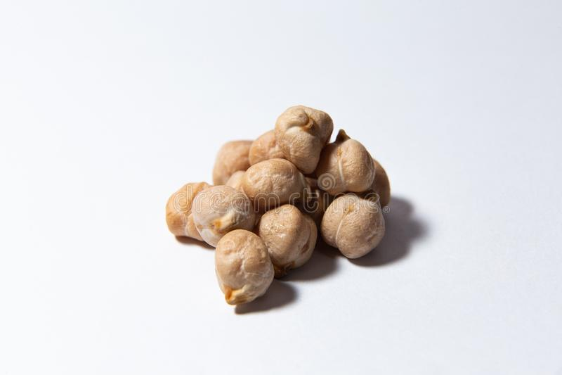 A handful of chickpeas lies on a white background royalty free stock images