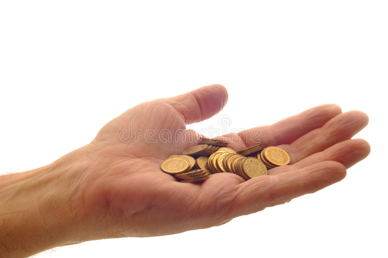 A handful of coins stock image