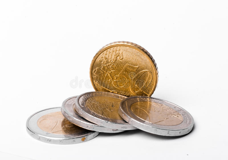 A Handful of Euros and Euro Cents. A handful of euro coins and euro cents various denominations on a light background stock photography