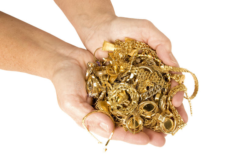 Handful Of Gold Ready To Sell For Cash Royalty Free Stock Image