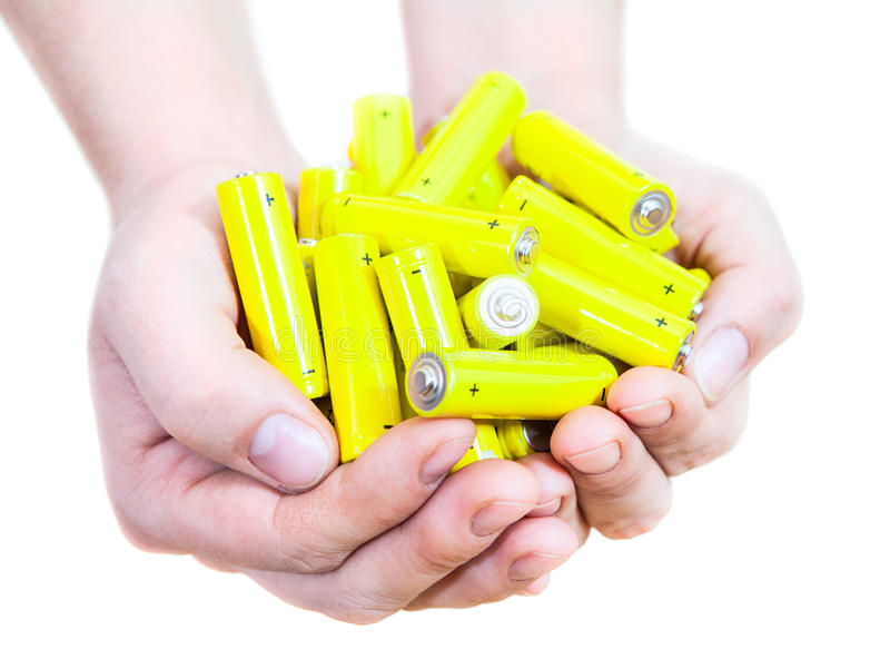 Handful with lot yellow penlight batteries isolated on white background royalty free stock photo