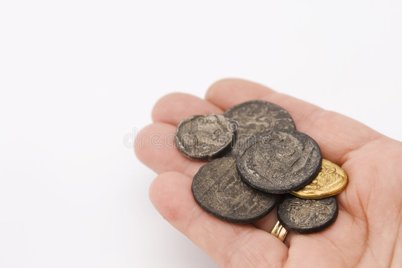 Handful of old roman coins. Hand with a collection of old roman coins stock photo