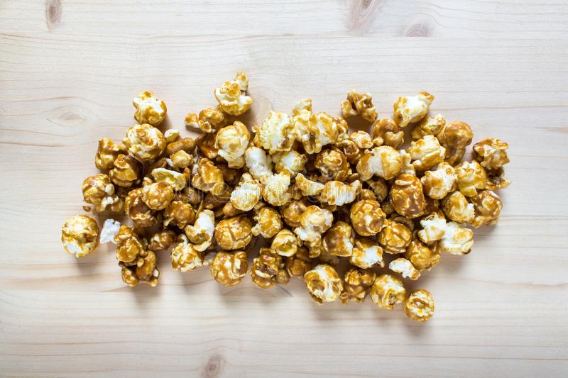Handful pile of sweet popcorn with caramel glaze royalty free stock photo