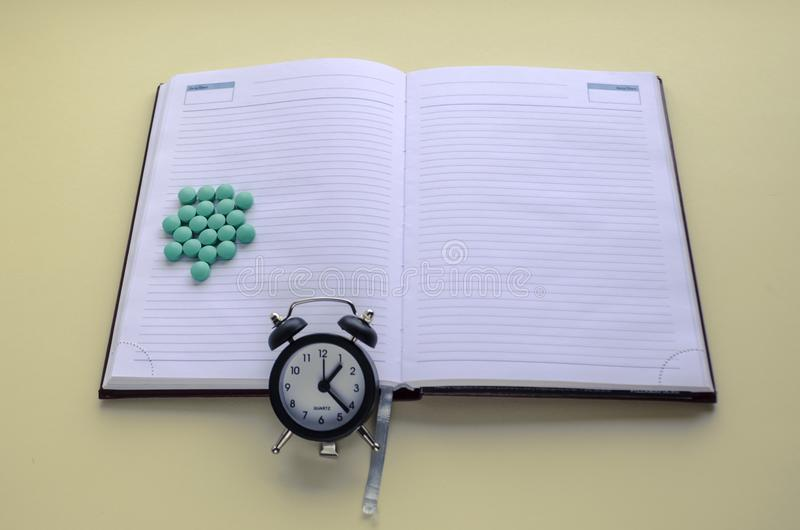A handful of pills, pills scattered, take pills on time, write in the calendar and diary royalty free stock photos