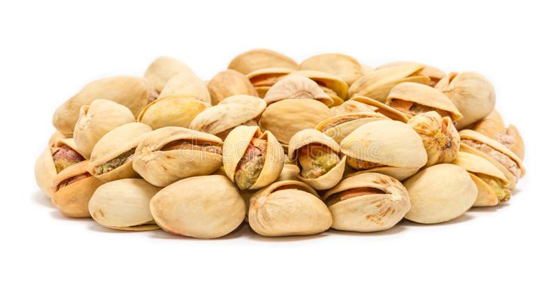 Handful of pistachio nuts Pistacia vera in the shell stock photo