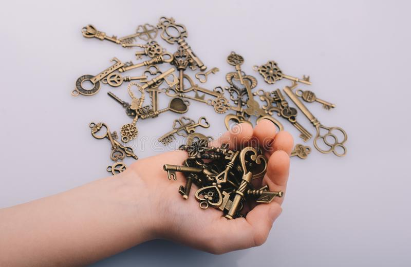 A handful retro style metal keys as business concept stock photos