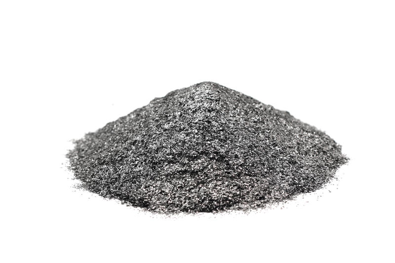 A handful of silver graphite powder stock photos