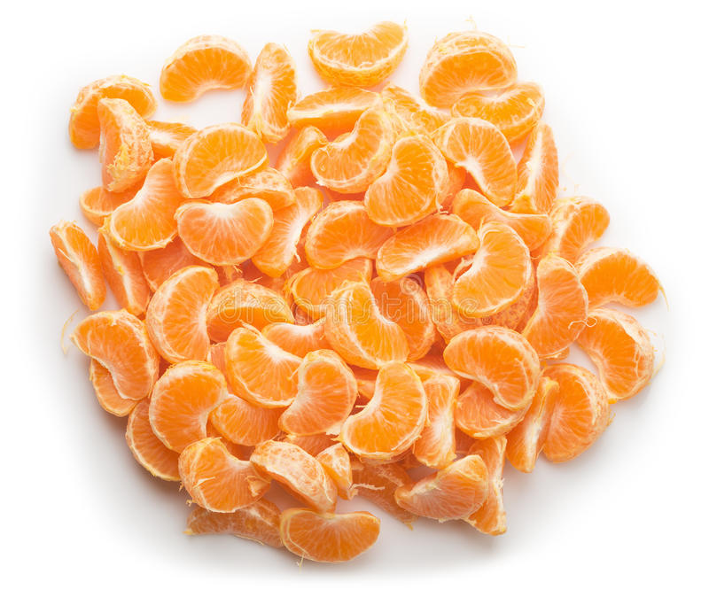 Handful of tangerine slices on the white background royalty free stock images