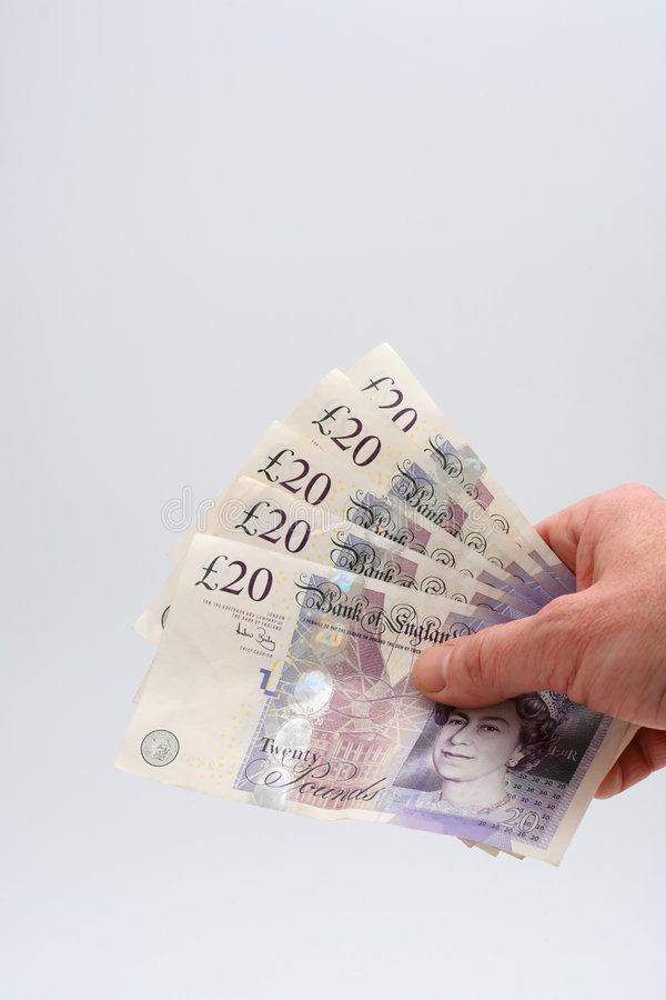 Handful of twenty pound notes royalty free stock photo